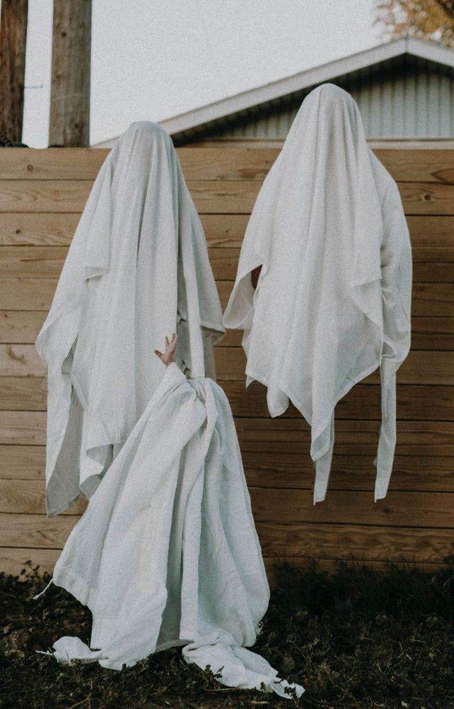 some children in their housecoats sleepwalking